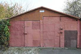 garage-made-from-red-metal-plates-with-4-doors